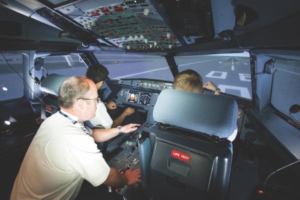 Pilots sitting in cockpit area